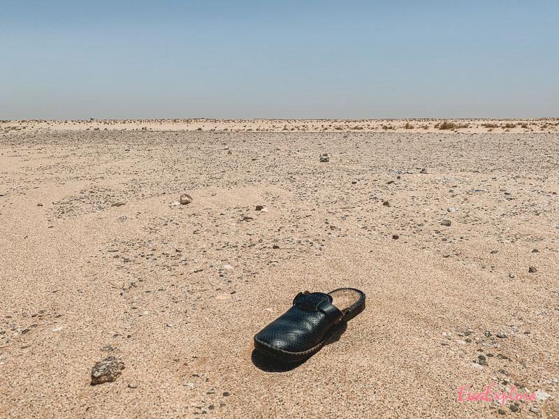 Schuh im Sand